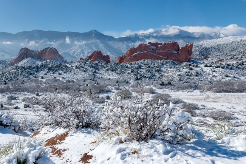 photo of a snowy Pikes Peak and Garden of the Gods