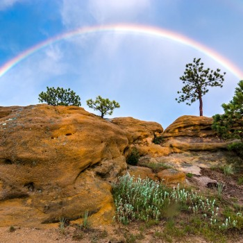 photo of a double rainbow over Colorado bluffs